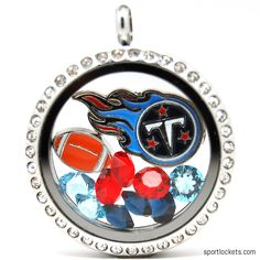 Tennessee Titans charm locket necklace from SportLockets.com.  Includes NFL licensed charm, football charm and Swarovski crystals in team colors.  Available in silver, black or gold with your choice of chain.