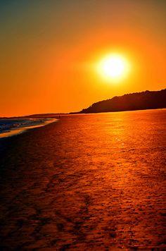 Golden winter sunset lights up the Hilton Head Island, South Carolina beach