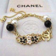 Chanel Gold Pearl & Enamel Bracelet / Chanel jewelry as seen on miranda carpenter Chanel Bracelet, Chanel Jewelry, Chanel Earrings, Jewelry Accessories, Fashion Accessories, Fashion Jewelry, Estilo Coco Chanel, Vivienne Westwood, Accesorios Casual