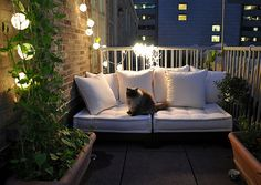 This is my idea of the perfect outdoor area. The hanging lights can be bought from IKEA, they are solar lights which is so handy.