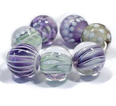 CLO Beads - Handmade Artisan Glass Lampwork Beads A set of large, focal sized beads done in layers of transparent purple or green and decorated