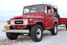 This 1981 Toyota Land Cruiser FJ40L is a rare factory soft top model featuring it's original 4.2 liter 2f inline six-cylinder engine and a matching custom trailer. A significant mechanical and cosmetic refresh was completed in February 2016 and is said to start easily and run well. The car is s