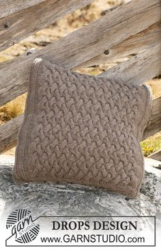 """Knitted DROPS cushion cover with cables in """"Alaska"""". ~ DROPS Design"""
