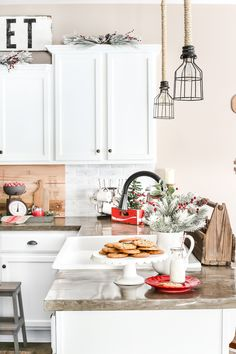 A tour of a Christmas table and kitchen decorated with pops of red and greenery, plus simple ideas for holiday styling on a budget. Christmas Kitchen, Rustic Christmas, Kids Christmas, Christmas Decor, Xmas, Holiday Decor, Porch Decorating, Interior Decorating, Interior Design