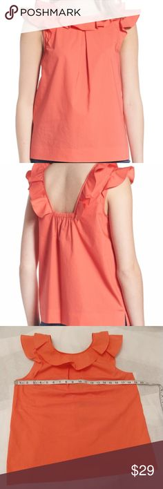 J.Crew Petite Ruffle Cotton Poplin Top. A feminine top with ruffles crafted in polished cotton poplin, bra-friendly silhouette to wear at work or on the weekend. 100% Cotton. Machine wash, line dry. Coral color. J. Crew Tops