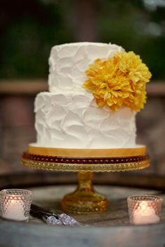 big ol' yellow flower on fluffy white #wedding #cake, heart.