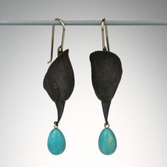 @QUADRUM Gabriella Kiss... Oxidized bronze bird heads earrings with turquoise egg drops.
