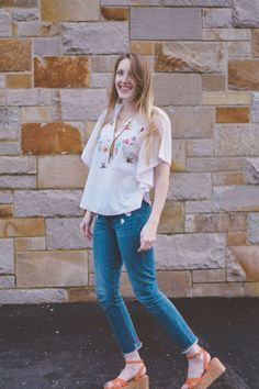 Leslie Musser wearing an embroidered vintage top for spring with Lovers + Friends raw edge denim and M.Gemi cork platform sandals // one brass fox