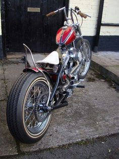 Evo sportster hardtail custom with white solo seat and red panel paintjob