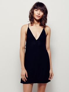 Little Secrets Slip   Effortless mini slip dress featuring a V-neckline and double tie detailing below the armholes. Open back with adjustable strappy accents for an easy fit.