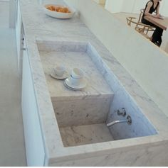 Architect Joseph Dirand created a stark marble sink in an ornate space in France.