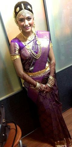 South Indian bride in a purple kanjevaraam saree.