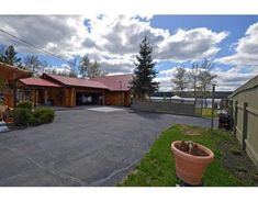 See 20 Photos and learn about the features of this Williams Lake, House. Williams Lake, British Columbia, Property For Sale, Sidewalk, Canada, Bedroom, Outdoor Decor, House, Home Decor