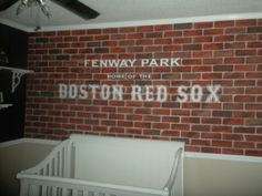 Custom baby room, by request.  A Red Sox fan in the midwest!  Handpainted brick wall, hand painted logos of the client's choice.  Such a fun project from the design, to the painting to seeing the clients being so happy when we were finished!