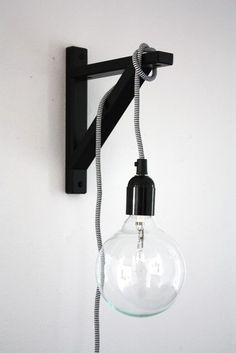 an ikea shelf bracket for hanging a light. about pop talk. an ikea shelf bracket for hanging a light. about Poppytalk. an ikea shelf br - Modern Wall Lights, Modern Wall Sconces, Modern Lamps, Luminaria Diy, Edison Lampe, Edison Bulbs, Ikea Regal, Deco Luminaire, Home Decor Hacks