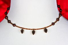 Be a big bronze winner this season with a glass and pinecone charm memory wire choker. $15 at #SmallestPlanet on #Etsy. Get 15% off your entire purchase with coupon code PIN15.