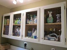 Love open cabinet doors, I am doing this to my kitchen cabinets, but this looks so cute in the laundry I may do it there too!