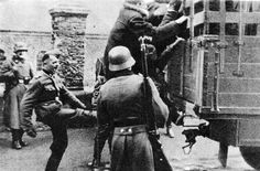 Jews are forced, with a little help from a Nazi soldier's boot, into a truck which is taking them to their execution.