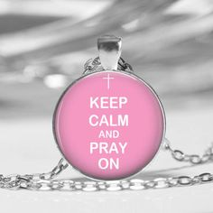 Keep Calm and Pray On Necklace or Key Chain  Glass Dome Necklace  Each pendant is made up of a laser printed image placed under a glass dome in a silver tone bezel.  Size: Round 1 inch (25mm)  Chain Length: 18 inch  link chain with lobster clasp.  Each ...