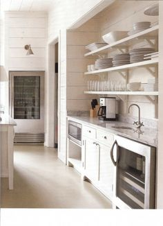 I have custom cabinets in my house but somehow am drawn to the open shelves in kitchen.