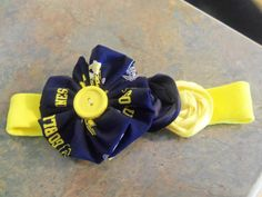 U of M headband....I am sure this could be made for any team you choose:)  @Jodi Thomas can tell you more, since she made it.