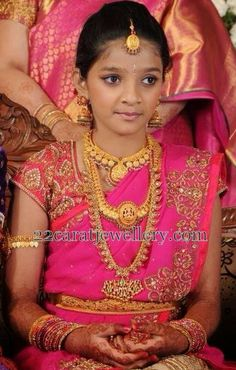 Jewellery Designs: Cute Girl Traditional Temple Sets