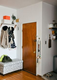 small space entry way - storage bench, hooks for coats, shelf w/ storage boxes above