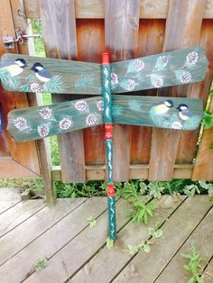 dragofly with chickadees hand painted on wings.. made out of ceiling fan blades