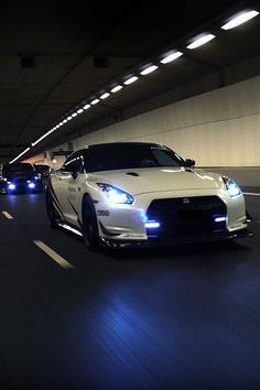 Inside a Tunnel comes a White Nissan GTR & other Cars Speeding tickets can cause you years of unwanted insurance fees and no one wants that go to https://payhip.com/b/wD1I to learn how to Beat Speeding Tickets
