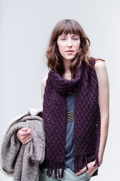 Bundle up in a chunky fringed scarf with a matrix of cables and openwork. The tiny two-stitch crossings can be easily worked without a cable needle, and yarnovers nestled in a background of reverse stockinette allow light to play through the deeply textured fabric. Oxbow is worked from one end to the other with garter …