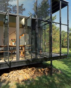 enochliew: Little Tesseract House by Steven Holl Architects This charcoal coloured cubic wooden structure is linked by an 'L' shaped exoskeletal steel and glass structure to an existing stone building.