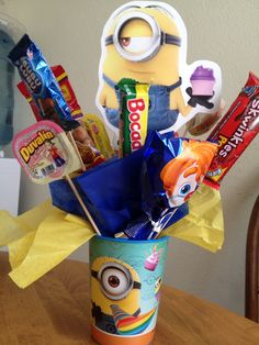 Inexpensive center pice for outdoor minion birthday party. We made a dozen for a little over $20 !