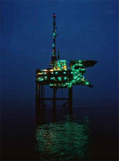 oil rigs at night | While oil-soaked birds get much attention, Gulf rigs remain bright ...