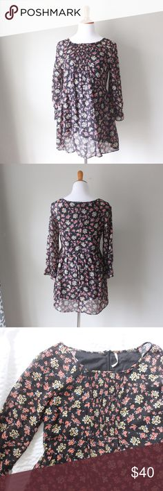 Free People Floral Long Sleeve Printed Mini Dress Floral printed Free People mini dress or Tunic with long sleeves. Back zip closure, no stretch. In gently used condition. All orders ship same or next business day! Free People Dresses Mini