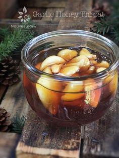 raw vegan Garlic Honey Throat, Cold and Flu Remedy displayed on barn wood