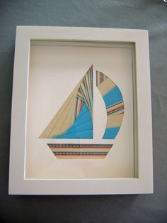 I folded fabric using iris paper folding technique - shadowbox sailboat for guest room