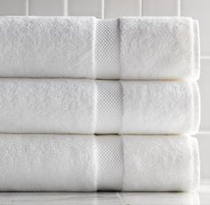 8 soft and Fluffy crisp white bath towels with matching hand towel And washcloths (don't care about brand)