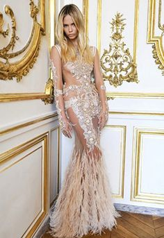 Natasha Poly in a breathtaking floor-length lace & feather Givenchy dress