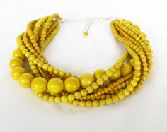 I'm thinking turquoise, navy blue, with ops of yellow and red. Chunky, bold jewelry and mix and match shoes.