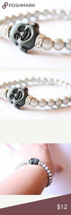 Happy Buddha Yoga Namaste Zen Beaded Bracelet New Grey happy Buddha stretch bracelet, made of milky white beads, with two round Swarovski Crystal beads on either side of the smiling Buddha. Bracelet looks great when worn alone, or stacked. Stretches to fit any wrist. Boutique Jewelry Bracelets