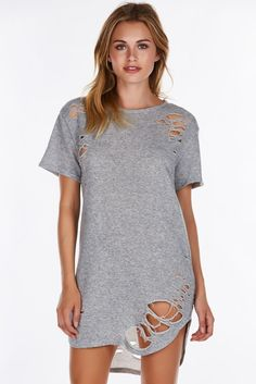If you're into the street-style look, you'll love this dope distressed tunic. Neckline mirrors the rounded hi-low hem with casual short sleeves. Amazing tears throughout for a vintage, worn out vibe.