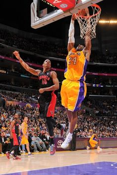 LOS ANGELES, CA - MARCH 8: Kobe Bryant #24 of the Los Angeles Lakers dunks against DeMar DeRozan #10 of the Toronto Raptors at Staples Center on March 8, 2013 in Los Angeles, California.