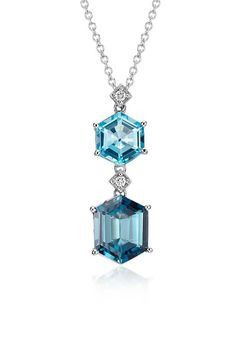 Truly sparkling something blue, this gemstone pendant features a unique hexagon shape blue topaz and london blue topaz with pavé diamond accents.
