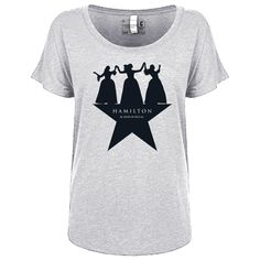 This ladies grey dolman scoop neck shirt features the silhouettes of the Schuyler sisters dancing on the Hamilton An American Musical key art.