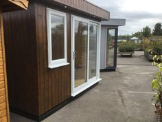 Contemporary garden office on display at Rivendell Garden Centre Solid Sheds, Garden Sheds For Sale, Garden Centre, Contemporary Garden, Garden Office, Wooden Garden, This Is Us, Windows, Display
