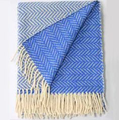 """Made from wool sourced from sheep in the mountains of Serra da Estrelas in the north of Portugal, CHEVRON WITH STRIPES is a take on the traditional zig-zag pattern with two colours, a repeated inverted """"V"""". With this striking new pattern, the strength of the familiar pattern takes on a new identity http://www.craftdesignconstruction.co.uk/mantas-portuguesas-blankets/"""