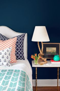 "For the children's room, Wilson used color to carve out space for her son, Penn (""Half of the room was pink, so he needed his own wall!""). Instead of pastels, Wilson chose a crisp navy-and-white palette, punching it up with poppy and aqua bedding and sophisticated extras, like a sculptural rope lamp. The timeless pieces, says Wilson, ""can work in any room in our next place."""