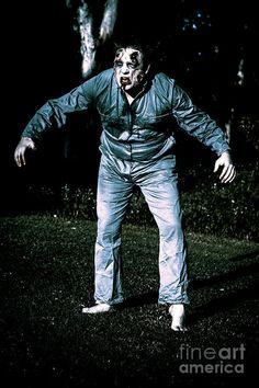 Creepy blue portrait of an evil dead horror zombie walking through graveyard during morning moonlight by Ryan Jorgensen