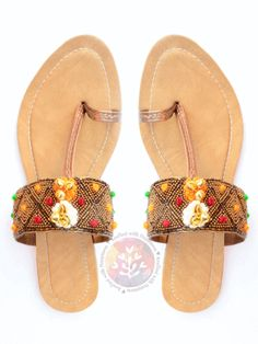 657f88c166aaa Made with precision these intricately designed colorful slippers are a  detailed with pom-poms   tiny golden bells are a must have summer essential.