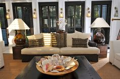 SHUTTER IDEA FOE INSIDE HOUSE FOR EXTERIOR TO LOOK GOOD plantation shutters home depot Living Room Tropical with black shutters lantern wall sconces natural fiber area rug